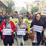 "Demonstration in support of protesting steel workers by their families in the city of Ahvaz, Iran, in December 2018. The placards read: ""We are the children of workers. We stand alongside them."" © Iranian Labour News Agency"